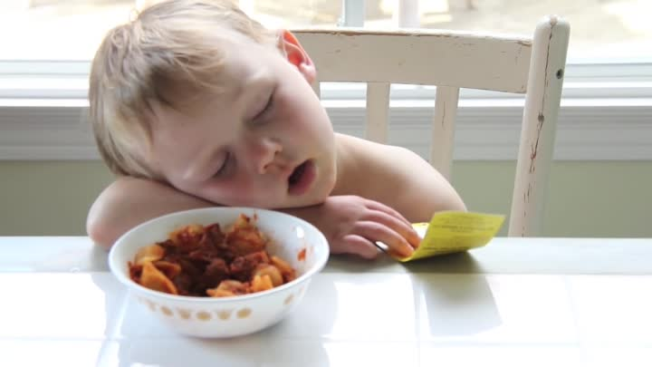 Видео: Boy Sleeping at Dinner Table after First Day of School
