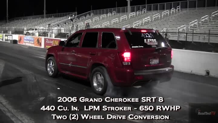 Fastest NA SRT 8 Jeep Cherokee vs Big Block Camaro - Wheelstand - Drag Race Video -- Road Test TV