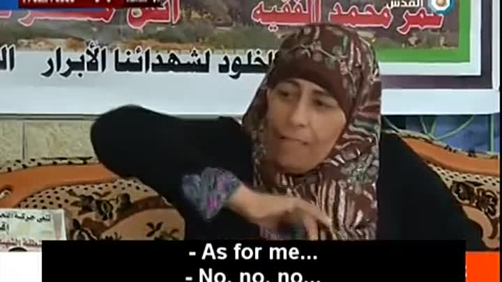 Mother of Killed Palestinian Terrorist Pulls Out Knife in Interview, Threatens to Carry Out Attack