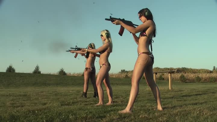 naked-woman-shooting-guns-gifs